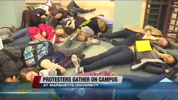 Marquette University students hold 'die in' protest.