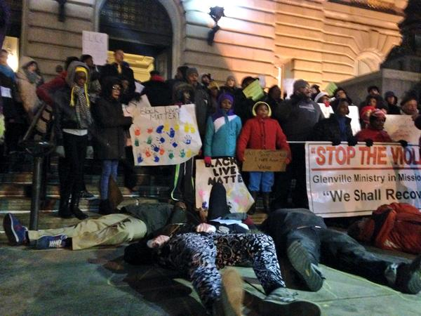 Die-in on the steps of Cleveland City Hall in advance of protest at last council meeting of the year. 100-200 ppl