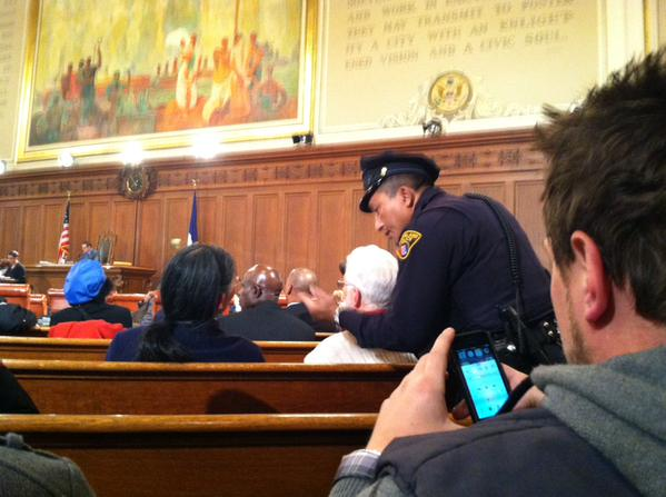 Officer demanding woman leave, crowd begins asking what her crime was  - Ferguson Commision