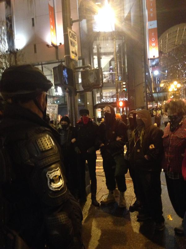 There's about 10 protesters and at least 3 times that many police officers at Seattle's Niketown