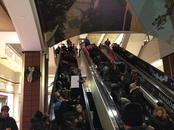 Die-in on the mall escalators. Atlantic Terminal, Brooklyn, NY