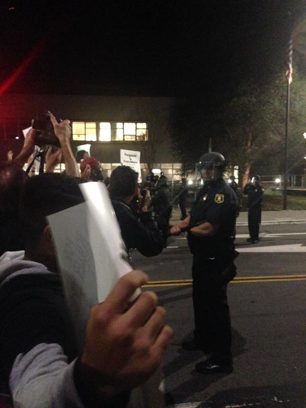 BerkeleyProtest police station yelling Let Us Through, officers telling protestors to stay behind rail