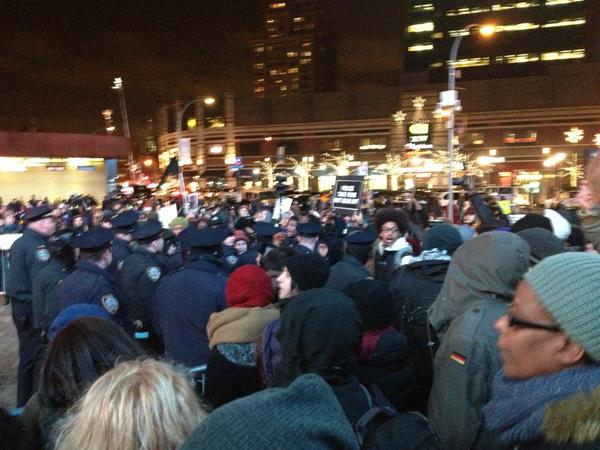 Protesters blocking an exit from the Barclays Center. Fans starting to exit. EricGarner