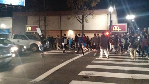 Someone's encouraging people to walk on both sides of University cars blocked up Shattuck intersection