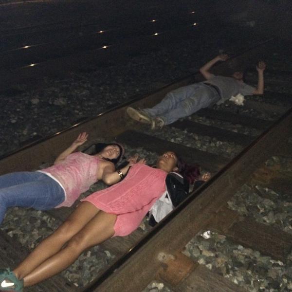 Die-in on the tracks blocking an Amtrak train Berkeley, CA