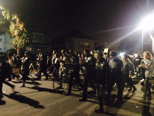 Crowd of about 400 moves eastbound on Channing, passing Milvia, shouting hands up, don't shoot berkeleyprotestts