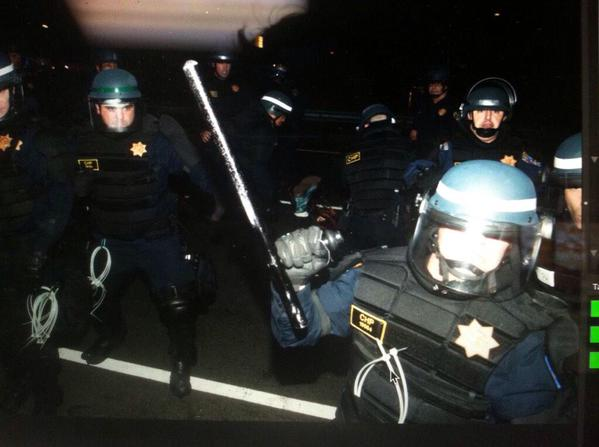 Police in BerkeleyProtests smash photographer @timhussin's lens