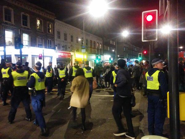 London solidarity protests with MikeBrown & EricGarner. Protestors are surrounded by the police