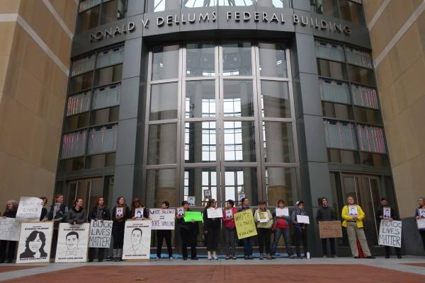 HumanRightsDay declaring BlackLivesMatter surrounding Oakland Federal Building.