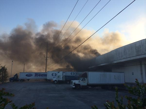 Smoke Blowing Over Miami International Airport From Warehouse Fire