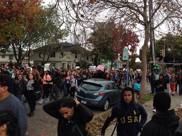 BHS students now heading south on MLK. Chanting Hands Up Don't Shoot. Traffic disrupted