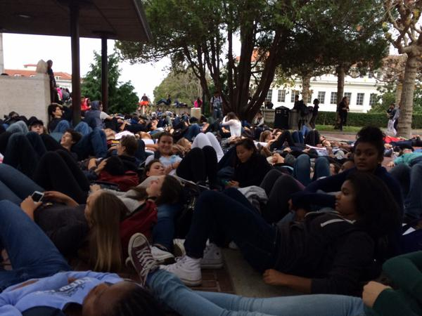 Berkeley High students perform a die in surrounding the Campenilli