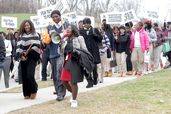 Jennings public school St. Louis, MO officials & students march together to police department to negotiate reforms.