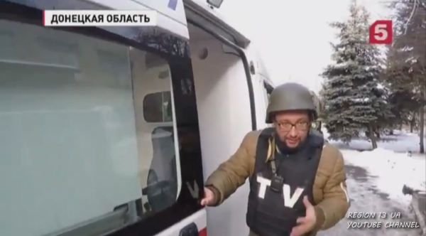 Russian press and soldiers traveling in an ambulance