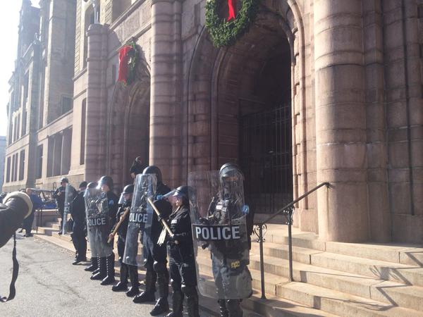 Outside @MayorSlay office, protesters chant Why are you in riot gear;we don't see no riot here!