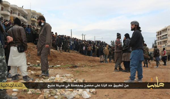 Syria. Manbij: Men and Boys gather for the stoning of an adulterer