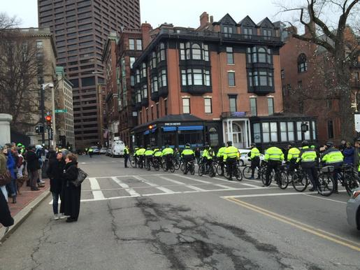 Boston bike police heading away from demo at statehouse
