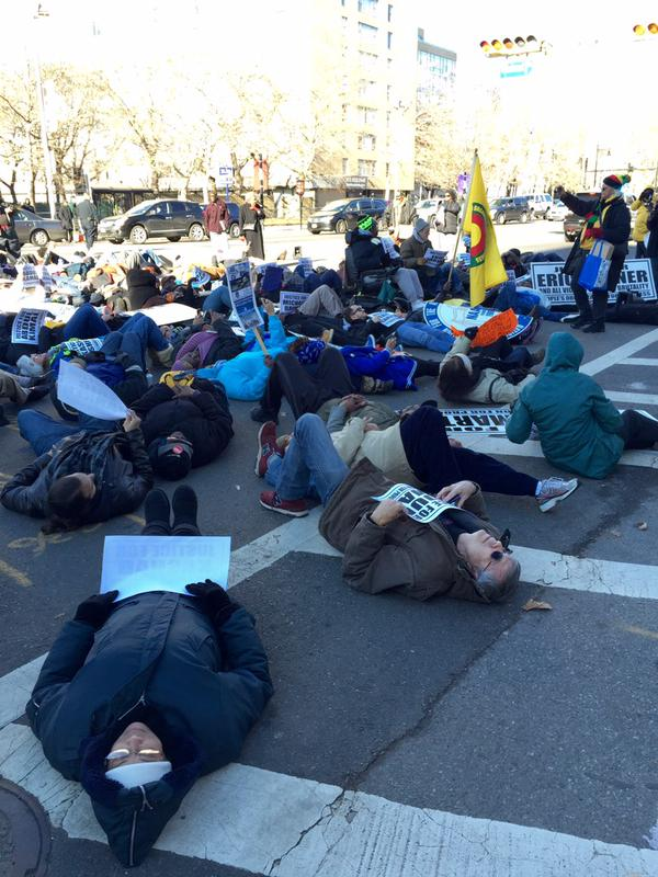 Newark protesters conduct a die-in front of the Federal Courthouse on Broad St