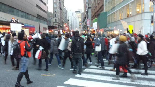 Helicopter overhead at Union Square as front of march moves south on Broadway from 14th Street. MillionsMarchNYC