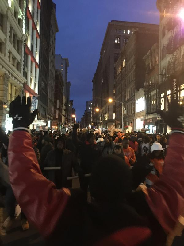 Marching down Broadway to NYPD HQ
