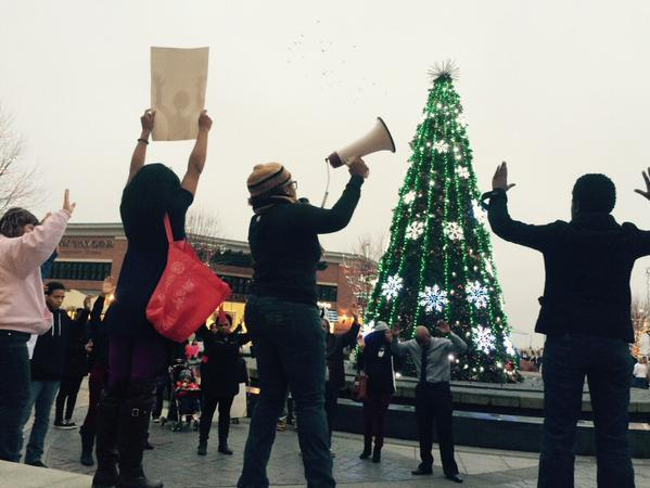 KansasCity stands with EricGarner & MichaelBrown at Legends shopping center