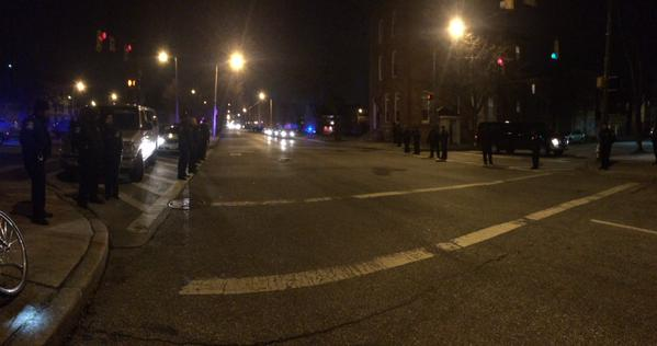 Police lining both sides of north Calvert street in Baltimore