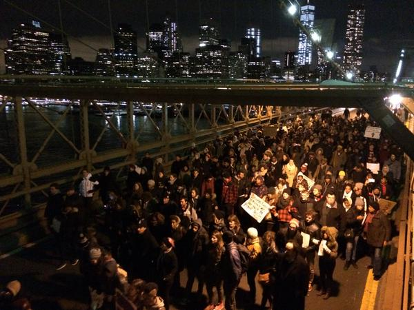 Protester on bullhorn on BK Bridge road: at the end of the bridge there's a line of cops...we need to stay together