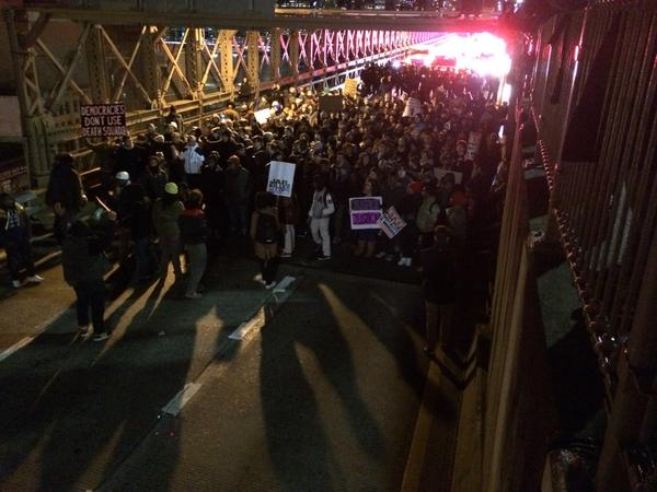 Protesters paused, cops paused with them, now march on BK Bridge continues MillionsMarchNYC