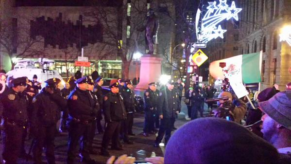 Police blocking Brooklyn Bridge, crowd pushing in. NYPD have batons