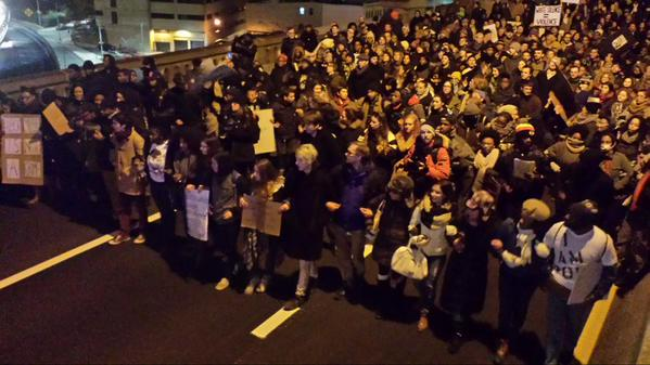 Arms linked ready to face any possible police line at end of Brooklyn Bridge. MillionsMarchNYC