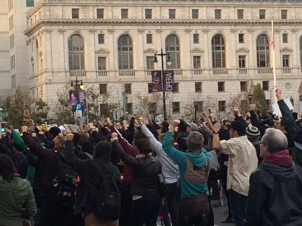 Whole crowd raises their fists in solidarity during EricGarner MikeBrown protest in front of City Hall in SF