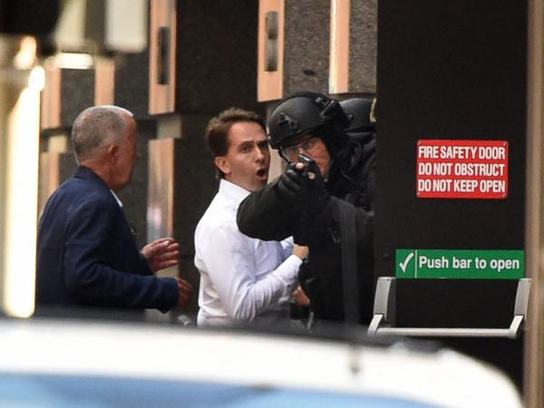 Hostage situation ongoing in Sydney business district, possible linked to ISIS