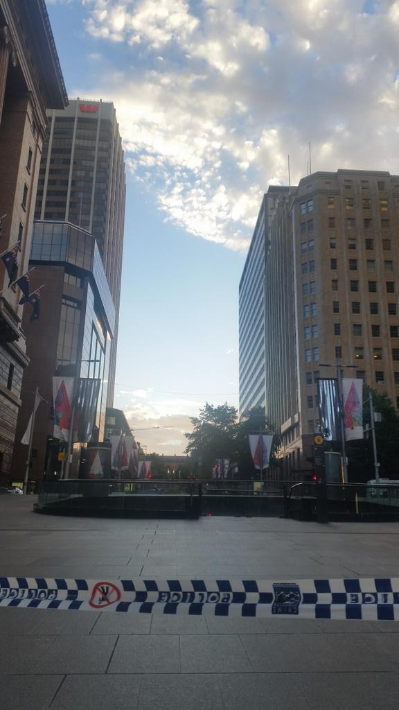 The sun now starting to rise over Martin Place after sydneysiege. 3 people dead. Including gunman