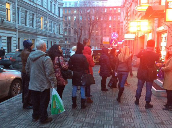 People are standing queue for currency in St. Petersburg