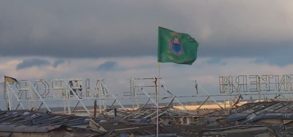 Ukrainian special services unit installs flag on top of Donetsk airport Terminal