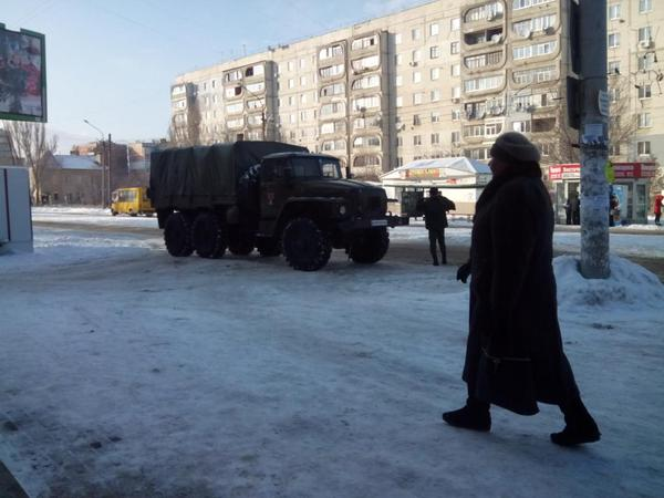 Luhansk. Rus. soldiers on military Ural truck came to shop for food