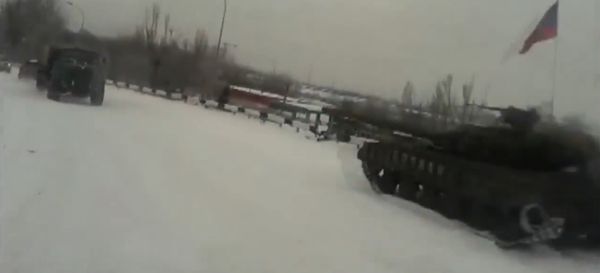 Cyborgs, defending Donetsk airport rotate,passing Russian invasion tank