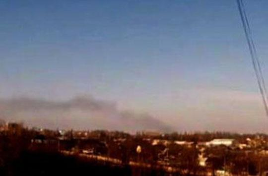 Black smoke In Donetsk airport is visible in almost all districts of Donetsk