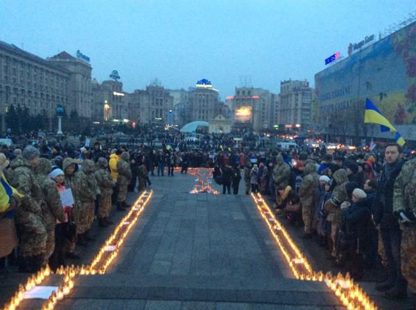 Candles are lit at the Maidan