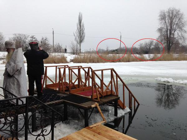 Priests preparing for Epiphany watch Russia military vehicles moving in Donetsk