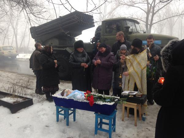 Funerals of Artyom, 4yo, killed by shelling on Sunday. Militants artillery moving around and shooting from the cemetery