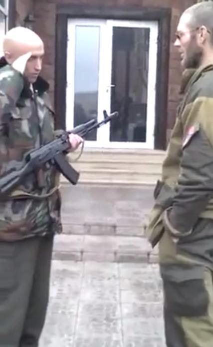 Graham Phillips in uniform and with a Kalashnikov