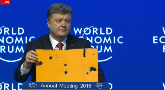 Poroshenko with a piece of the Volnovakha bus at Davos2015