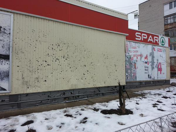 Supermarket Spar in Shastye. 120 mm mine hit next to the building and killed two people