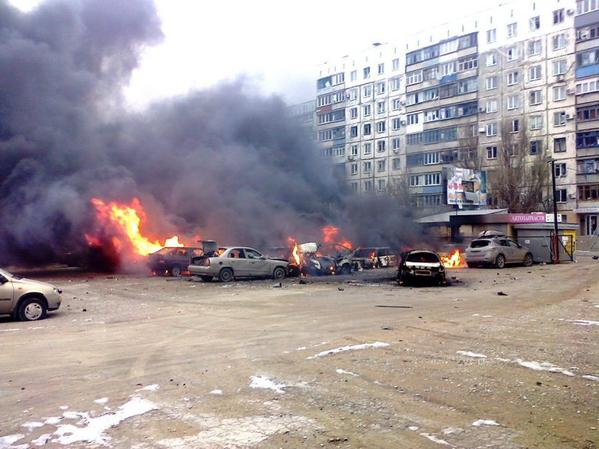 Burning cars in Mariupol