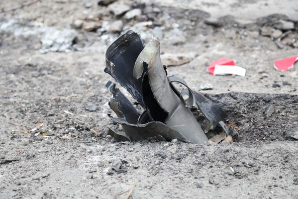Rocket remnant stuck in ground in east Mariupol, showing that the rockets came from east