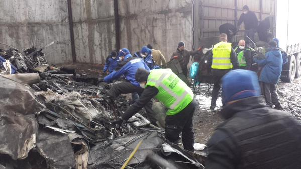MH17 recovery team loads pieces into truck for further examination