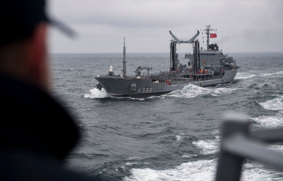 USSRoss in Black Sea: Turkish TCG Yarbay Kudret Güngör navigates alongside Ross, Lt. Gregory on watch, Boatswain's Mate 3rd Class Cheek re-enlists